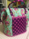 A large poppins bag with tula pink fabric.