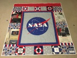 The back of this quilt is a memory quilt for my husband with his NASA award certificates on it.